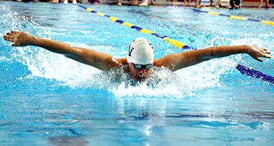 Junior Cole Mansker performs the 100 Butterfly, breaking the previous record on Feb. 5.