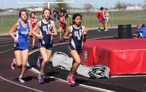 Grace Hannemann and Marisa Ibarra compete in the 3200 meter run.