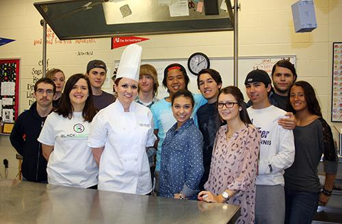 Teacher of the Year, Chef Lauren DeLoach, poses with her fourth period class on March 4.