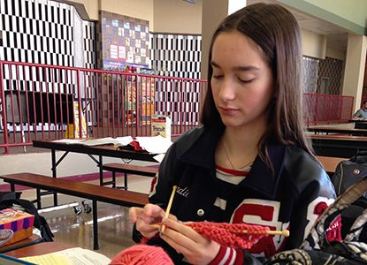 Senior Bradie Dean knits in her downtime at the UIL meet at Judson.