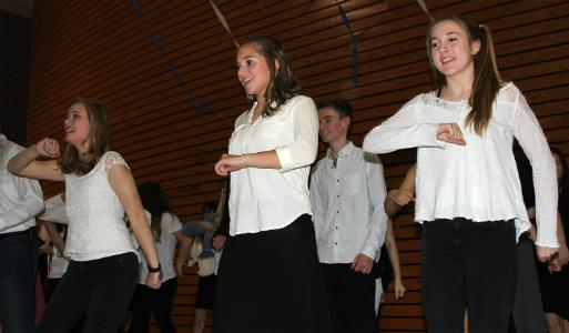 At the 2016 Dinner and a Song, senior Madelyn Deviney and freshmen Amanda Charlton and Bethany Kleck dance to the music.
