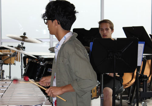 Senior Matthew Torres practices keyboard instrument in the senior dining hall. The percussion team has prepared for the