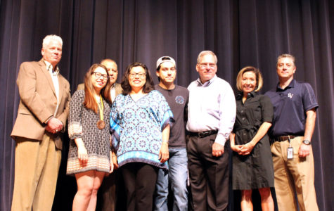 Kaitlyn Ecoff and family accept Pruedential Spirit Award with Ronald Swanson, Jose Perez, Micheal Wahl, and Christine Rostedt.