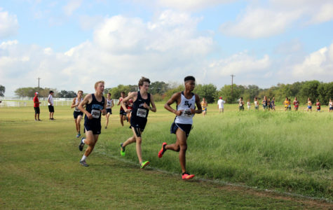Junior Desmond Henderson makes final lap to approach the finish line.