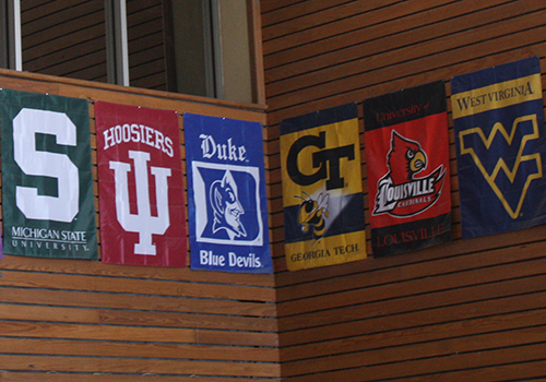 Some of the college banners hanging in the senior dining hall.