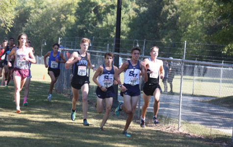 Clayton Wilkerson and Andres Engle lead the pack at the Chili Pepper Festival race on Sept. 30. The boys varsity came out in first place out of all teams in the race.
