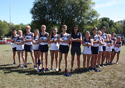Varsity cross country boys and girls celebrate their formidable showing with Coach Brittney Lanehart at the Chili Pepper festival in Arkansas on Sept. 30.