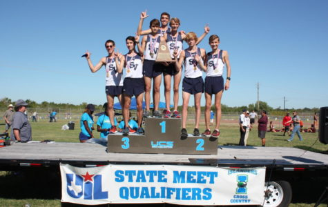 The boys cross country team celebrates after a first place finish at the Regional Championships on Oct. 23.