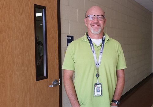 Mr. Pick outside of his classroom.