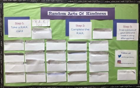 Random acts of kindness board is located outside the campus library.