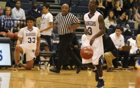 Junior point guard Justin Nutt advances down the court to set up the offense during the 48-44 loss against Alamo Heights on Nov. 21.