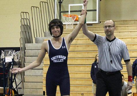 Wrestling throttles regional competition