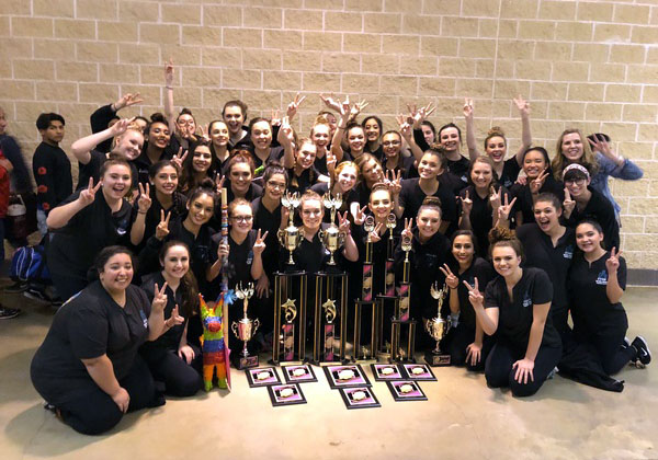 Silver Spurs dance team celebrates their victories at a former Crowd Pleasers competition.