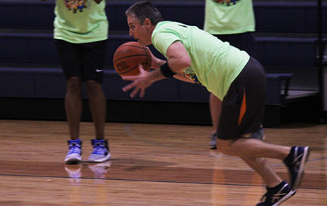 After stealing back the ball, principal Michael Wahl  heads to the basket during the faculty-student basketball game for SPUD week Wednesday.