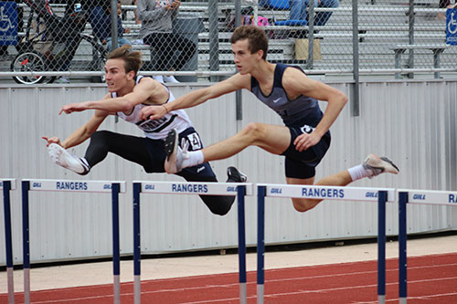 Junior Jeremiah Gilliam leaps over the hurdle during the 110M race during the Ranger Relays on March 3.