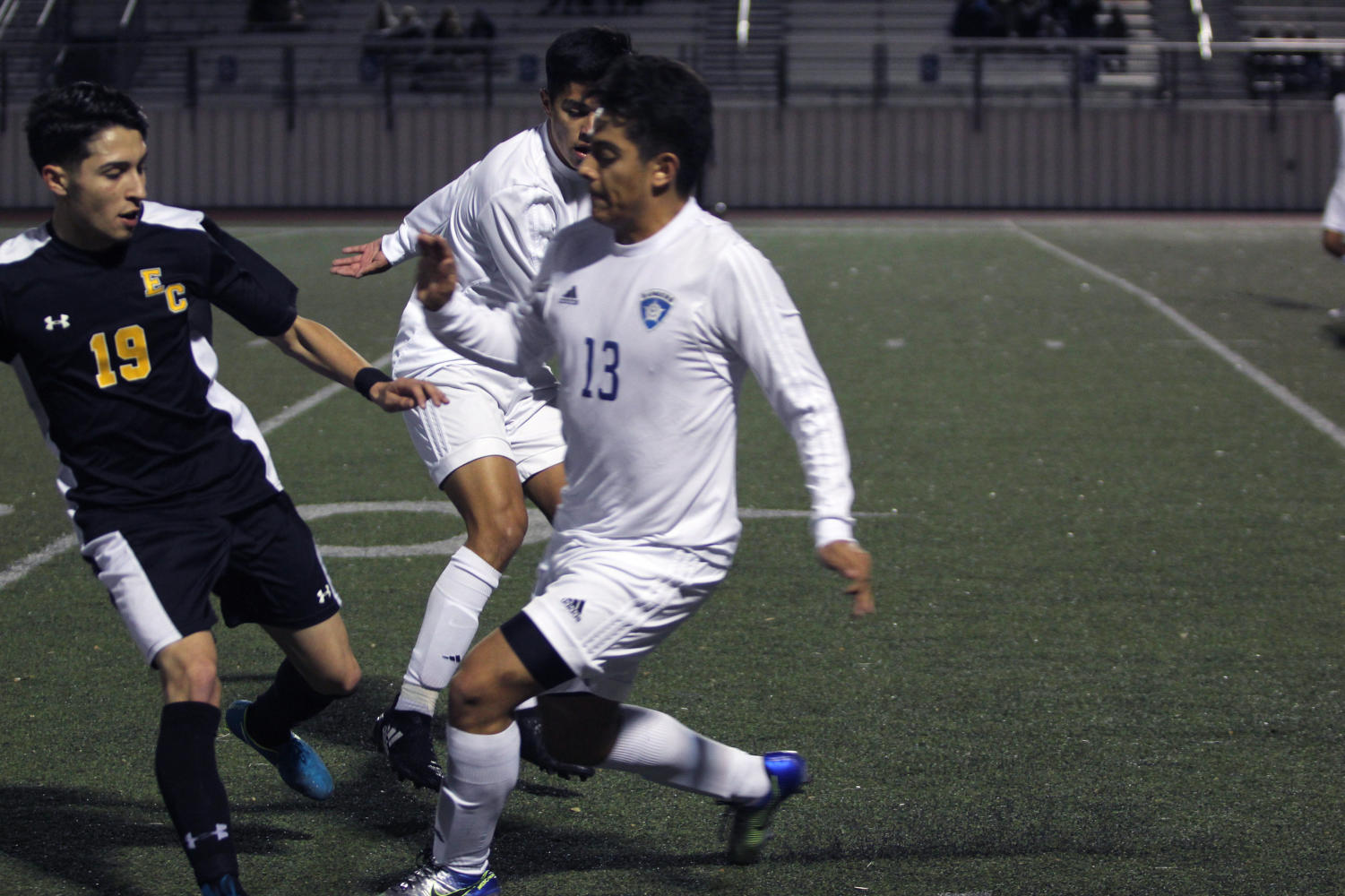 Senior Nathaniel Diaz slices through the defense during the teams 2-0 victory over East Central at home on Feb 2.