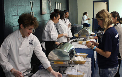 Seniors Hakey Mock, Sophia Kissel Faith Mundia, junior Denise Girarte and senior Samantha Pearson show off the skills they learned this year by serving food  they prepared to SVHS staff and family members May 4.
