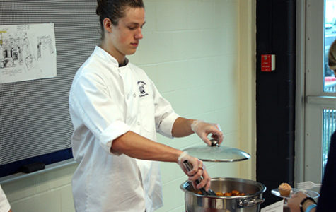 Junior Zachary Stallings serves Zeppoles for culinary on May 4.