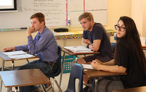 Juniors Sean Gunther, Cade Gibson and Kaley Bared look over a released AP Seminar test on May 7 to prepare for their test tomorrow.