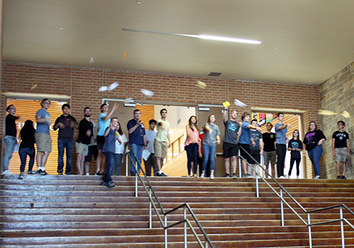 AP physics 1 students to a group test of their paper airplanes lab down the main hallway.