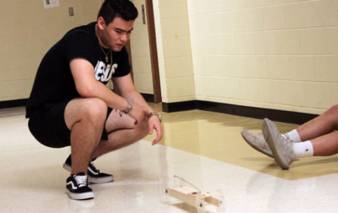 Sophomore Michael Freitas tests his mouse trap car for engineering on May 2.