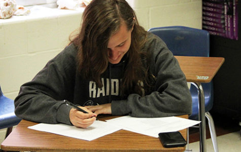 Senior Colette Montminy works on an English essay durring her off period on May 3.