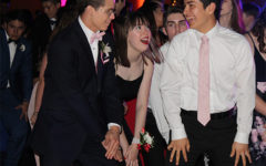 Seniors Garrett Snowden, prom queen Maggie Luhrman and Josh Martinez move their hands and legs to the music (from Prom 2018)