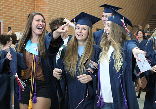 During their senior walk today, seniors Erica Martinez, Lauren Poskon and Haley Oatman celebrate with family and friends.