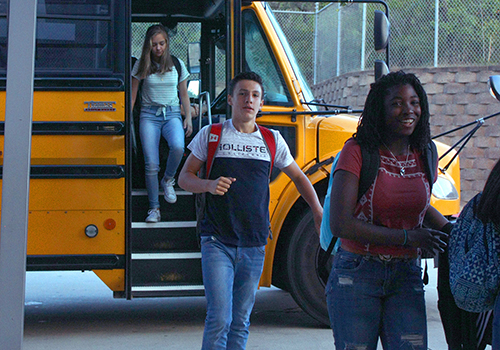 Bus riders enter the Rotunda on the first day of school, Aug. 28.