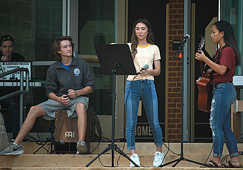 Juniors Lauren Gonzalez, Esther Hicks, and Will Yancosek prepare for their next song at See you at the Pole.