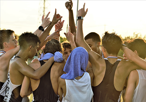 The boys cross country team celebrates their run at the Vista Ridge meet on Aug. 24