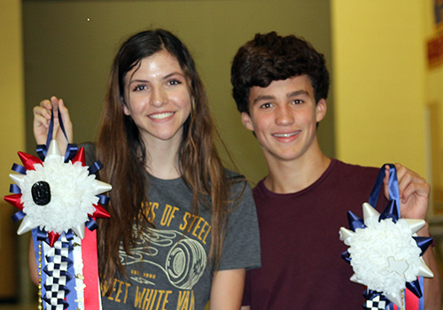 Students in Heather Sanders's floral design class show off the mums they created in class.
