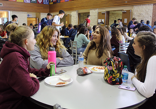 During C lunch, seniors Kiersten Tomerlin, Abigail Johnson and Olivia Anaya share a laugh with Alexys Vallejo in the senior dining hall.