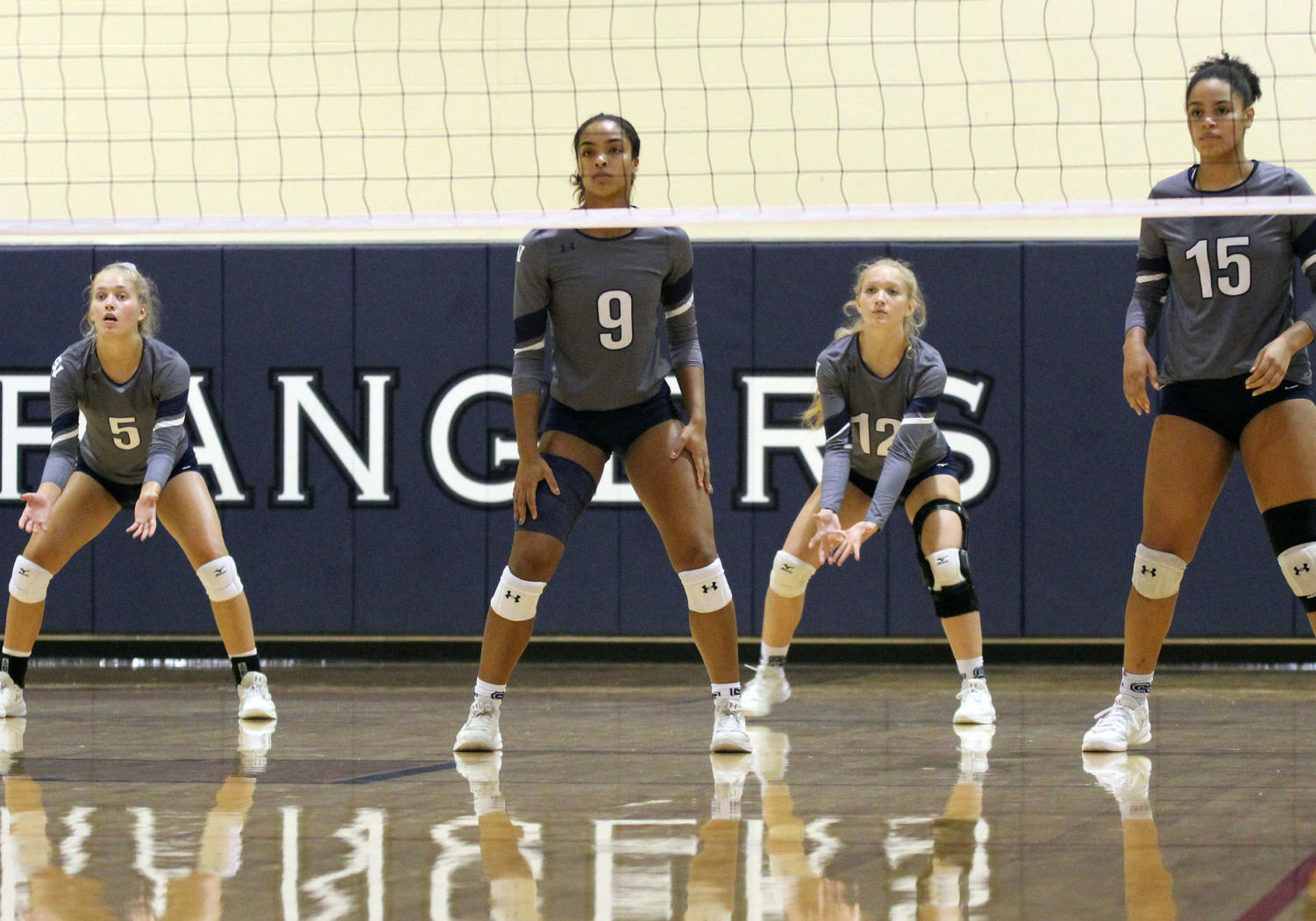 The team looks on to receive the opponents serve as they faced off against San Antonio Jefferson on Sep. 24