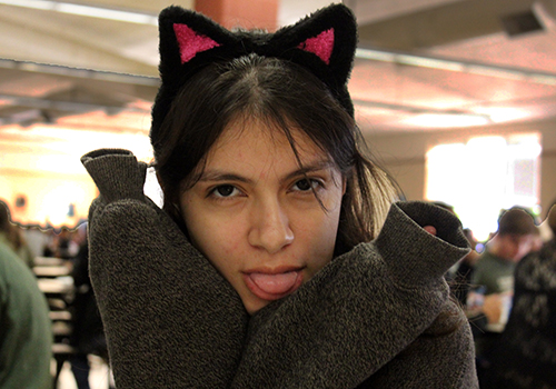 Ready for Halloween fun, junior Victoria Quinones puts on her cat face in the cafeteria.