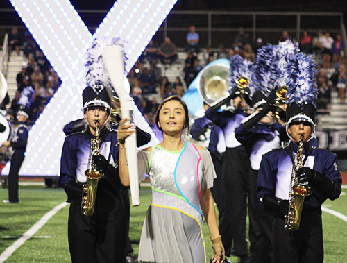 At the Steele football game, band members Alyssa Wagner, Adam Cevallos and Senior color guard member, Aliyah Wotenia perform their UIL show eXpiriment 78070.