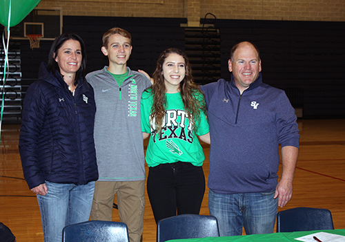 Flanked by cross country coaches Britney Lanehart and Nathan Nunley, seniors Mason Garner and Arianna Gonzales celebrate signing their letters of commitment to the University of North Texas.