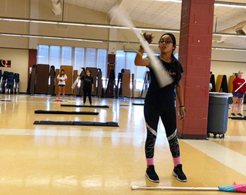 "Freshman Ariel Melendez warms up on her rifle during her seventh period color guard class. ""I think that it will be interesting to see a skill level difference between newbies and veterans, separating us and all,"