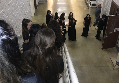 During the holiday concert Monday in SVHS Auditorium, choir members line the steps down into the foyer as they wait for their chance to perform. The concert featured a Hallelujah Chorus at the end.