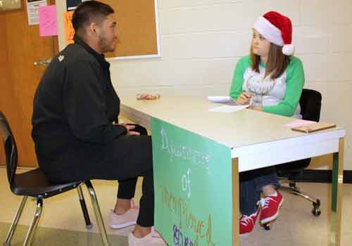 As part of his final exam in Leslie Weil's career prep class, Julian Pumpernickel (a.k.a. senior Aden Jacks) interviews  with Weil to become one of Santa's Elves in the Department of Unemployed Elves.