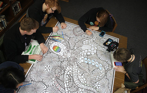 Before school, juniors Josephine Ford, Max Oliver, Liahm Nowak, Abigail Lewis and Carsyn Chambers add their artistic touches to the giant coloring page in the library Thursday, Jan. 24.