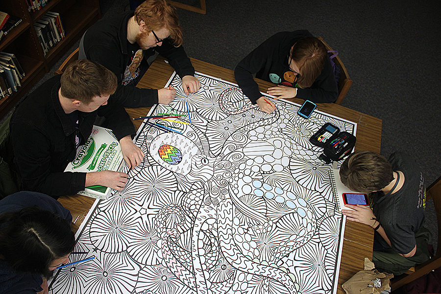 Before+school%2C+juniors+Josephine+Ford%2C+Max+Oliver%2C+Liahm+Nowak%2C+Abigail+Lewis+and+Carsyn+Chambers+add+their+artistic+touches+to+the+giant+coloring+page+in+the+library+Thursday%2C+Jan.+24.+