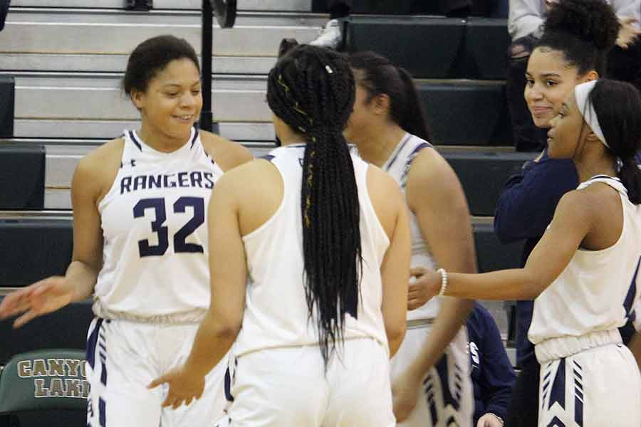Junior Brianna Grell's teammates hype her up as she's introduced in the starting lineup. Teammate Tanyse Moehrig was sidelined from a knee injury on Jan. 8 against Judson.