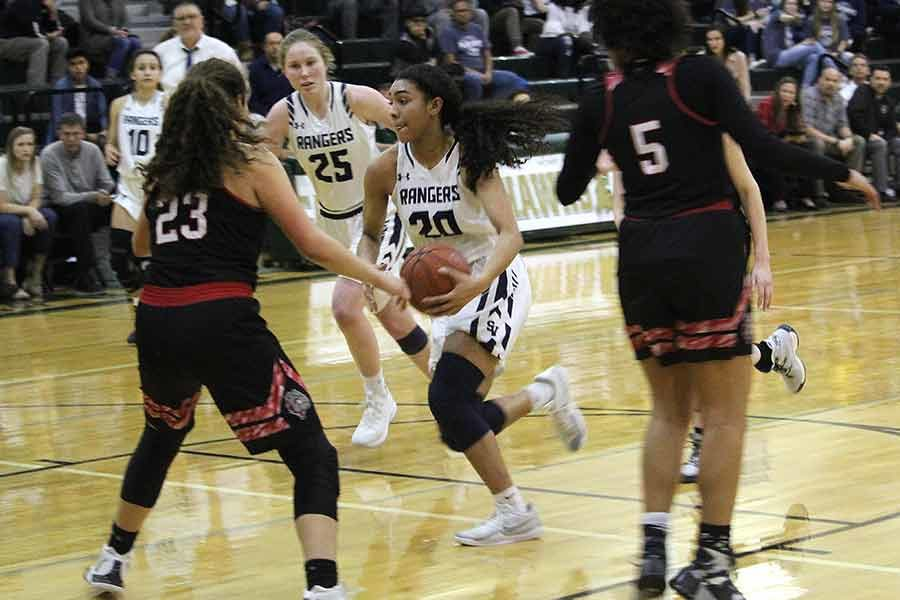 Junior Anika McGarity drives through the lane against Bowie at Canyon Lake High School on Feb. 11. McGarity ties school record with 73 three-pointers this season.