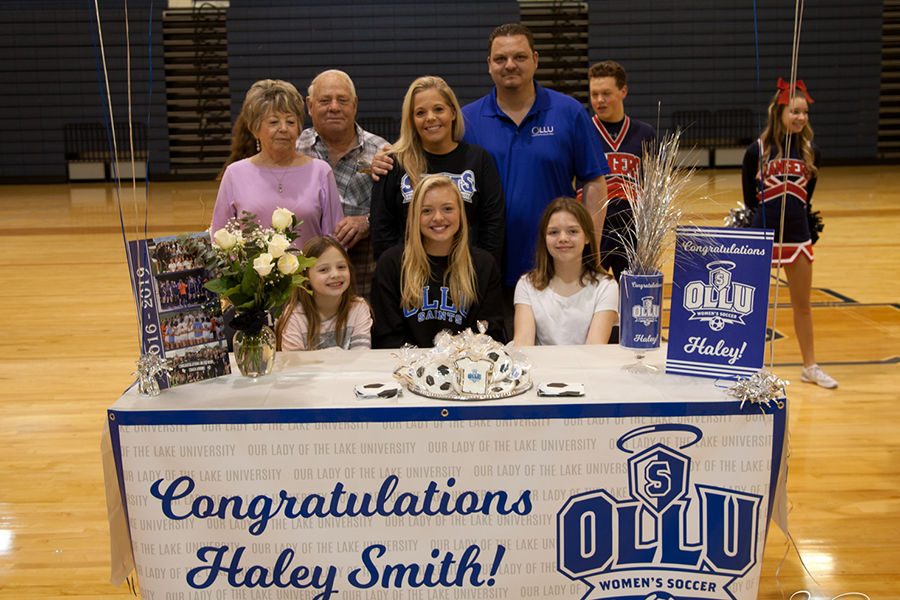 Surrounded+by+friends+and+family%2C+Haley+Smith+inks+her+commitment+to+play+soccer+at+Our+Lady+of+the+Lake+University+in+San+Antonio.