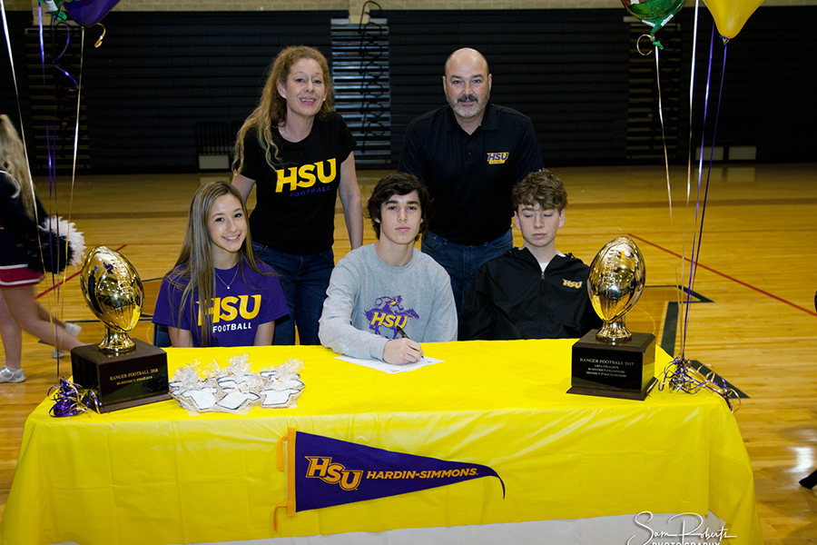 With+his+family+by+his+side%2C+Christian+Romano+signs+his+letter+of+intent+to+play+football+at+Hardin-Simmons+University.