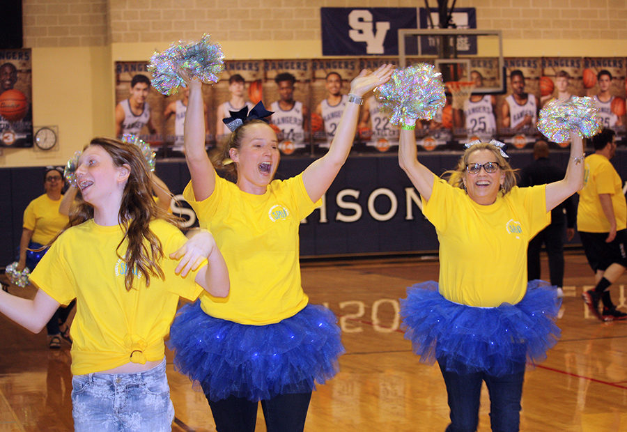 Donned+in+blue+tutus%2C+faculty+cheerleaders+L.+Sellers+and+Claudia+Barthuly+cheer+on+the+faculty+during+the+SPUD+basketball+game+Tuesday.+Faculty+win%2C+64-62.