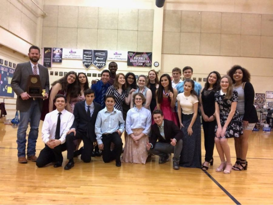 The+cast+and+crew+of+%22GINT%22+celebrate+their+trophies+and+medals+along+with+a+first+place+finish+in+district.
