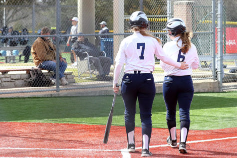 Softball copes with coach's absence