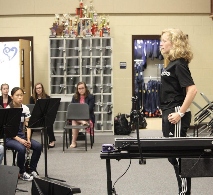 Sophomore french hornist stands firm for her audition as sophomore clarinetist Iris Bradbury, sophomore flutist Maya McBrayer, and junior Caroline Kuhn observes.